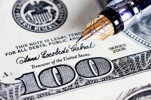 Pen on a $100 Bill - Littleton Coin Blog