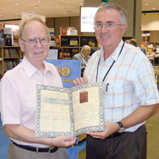 Kenneth Bresset, author of the Red Book and contributor David Sundman of Littleton Coin talk shop at a show