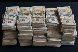 Stacks of prop money - Littleton Coin Blog
