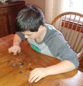 Sam looking at coins - Littleton Coin Blog